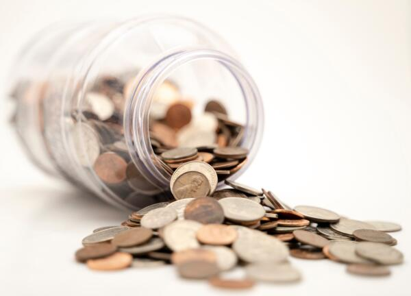 coins falling out of jar