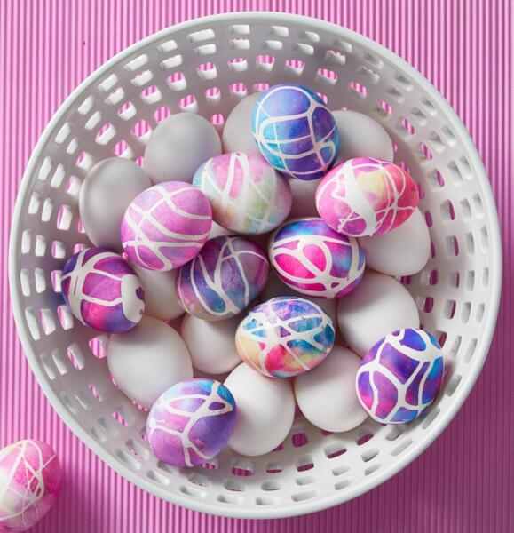 Pink, blue, and purple dyed easter eggs in bowl